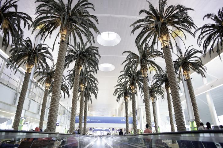 DUBAI INTERNATIONAL AIRPORT, DUBAI OCTOBER 27: Dubai International Airport With Glorious Duty Free Section On October 27, 2013. Dubai International Is One Of The Fastest Growing Major Hubs