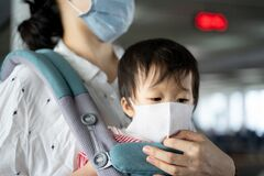 Asian Baby Mother Baby Carry Both Wearing Protection Mask Against Air Pollution Corona Virus Mother Ensure Baby Wear 172234244
